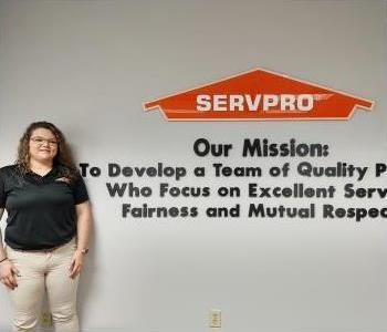 Head shot of female SERVPRO of Greensboro North employee with brown hair wearing a black ServPro logo polo.
