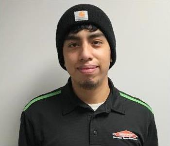 Male ServPro of Greensboro North Employee wearing a toboggan and black ServPro logo polo with green stripes on the shoulders.