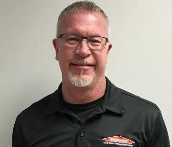 Head shot of male ServPro Greensboro North employee wearing glasses and company polo.