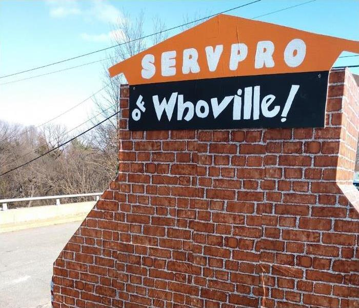 SERVPRO of Whoville sign attached to makeshift chimney underneath blue sky.