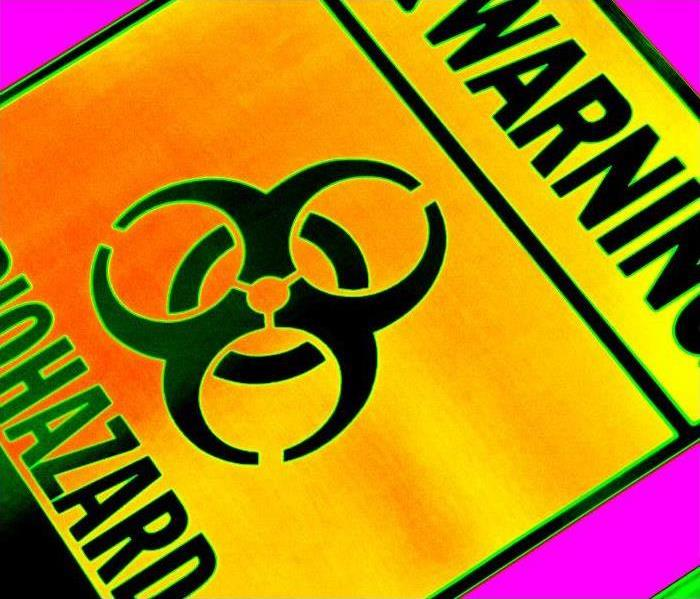 biohazard symbol on yellow-orange square with black stripes horizontal and warning on the top, biohazard on bottom.